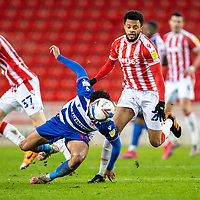 6th February 2021; Bet365 Stadium, Stoke, Staffordshire, England; English Football League Championship Football, Stoke City versus Reading; Josh Laurent of Reading stumbles and Jordan Cousins of Stoke City chases the loose ball