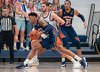 WASHINGTON, DC - NOVEMBER 16: Jamison Battle #10 of George Washington defends against Troy Baxter #13 of Morgan State during a game between Morgan State University and George Washington University at The Smith Center on November 16, 2019 in Washington, DC.