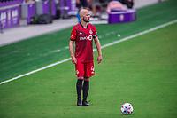 ORLANDO, FL - APRIL 24: Michael Bradley #4 of Toronto FC waiting to kick the ball during a game between Vancouver Whitecaps and Toronto FC at Exploria Stadium on April 24, 2021 in Orlando, Florida.