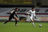 Pictured: Jordi Gomez of Swansea (R) chased by Marciano Van Homoet of Barnsley (L)<br />