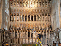 BNPS.co.uk (01202 558833)<br /> Pic: PhilYeomans/BNPS<br /> <br /> The spectacular 'Reredos' screen of New College chapel in Oxford gets an annual check over by maintenance staff as college life slows and students of the 640 year old institution return home for Christmas.<br /> <br /> If the scene looks familiar its because the stunning chapel has appeared many times in film and on TV, most recently in the current BBC series 'His Dark Materials' as well as Harry Potter, Mamma Mia 2 and Tom Cruise's The Mummy.<br /> <br /> Although called 'New' College, the famous seat of learning was actually founded in 1379 by William of Wykeham, Bishop of Winchester and Chancellor to King Edward III, when his family motto 'Manners makyth Man' was adopted by the college.<br /> <br /> The reredos was restored in 1892 after the original was attacked by Reformation zealots in the sixteenth century, who had unfortunately smashed the carvings and plastered over the niches.