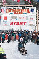 Tim Osmar team leaves the start line during the restart day of Iditarod 2009 in Willow, Alaska