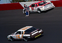 Dale Jarrett climbs from his car after crashing in the Atlanta Journal 500 at Atlanta International Raceway in Hampton, GA, November 1988.  (Photo by Brian Cleary/www.bcpix.com)