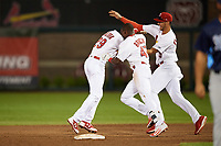 Springfield Cardinals left fielder Magneuris Sierra (29) is mobbed by teammates Jose Adolis Garcia (47) and Jack Flaherty (22) after a walk off single in the bottom of the ninth inning during a game against the Corpus Christi Hooks on May 30, 2017 at Hammons Field in Springfield, Missouri.  Springfield defeated Corpus Christi 4-3.  (Mike Janes/Four Seam Images)