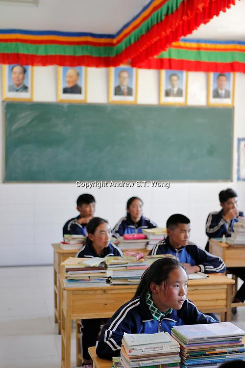 Nangqen County, Yushu Tibetan Autonomous Prefecture, Qinghai Province, China - Tibetans learn underneath portraits of China's Communist leaders, August 2019.