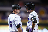 Winston-Salem Dash manager Ryan Newman (5) gives instructions to AJ Gill (7) during the game against the Greensboro Grasshoppers at Truist Stadium on June 17, 2021 in Winston-Salem, North Carolina. (Brian Westerholt/Four Seam Images)
