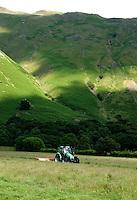 Mowing grass,Patterdale, Cumbria, Lake District.....Copyright..John Eveson, Dinkling Green Farm, Whitewell, Clitheroe, Lancashire. BB7 3BN.01995 61280. 07973 482705.j.r.eveson@btinternet.com.www.johneveson.com