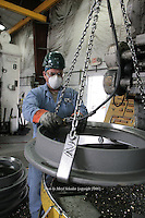 Manuel Pantoja works as a machinist at the D & L Foundry in Moses Lake, Washington on August 16, 2006. The factory produces iron manhole covers.