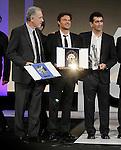 Spanish film director Fernando Trueba with the Silver Shell best director award (l), French film director Francois Ozon with the Golden Shell best film award (c) and the writer Juan Mayorga during the Awards Gala in the 60th San Sebastian Donostia International Film Festival - Zinemaldia.September 29,2012.(ALTERPHOTOS/ALFAQUI/Acero)