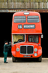 Pictured: James Freeman, Chairman of The Friends of King Alfred Buses polishes the wing mirror of a red 1964 AEC Renown vintage bus no. 596 at the bus depot near Romsey, Hants during what would typically be a busy period leading up to the King Alfred Buses Running Day event, which has been cancelled this year due to the coronavirus pandemic. <br /> The annual event, usually held in May sees 20 heritage buses from as early as the 1950s providing free services through the city of Winchester and surrounding villages. <br /> <br /> The Friends of King Alfred Buses have taken the decision to cancel this years event, citing the effects of the coronavirus pandemic and the uncertainty around what kind of public events are permissible in the next few months. <br /> <br /> The vintage buses are still expected to play a part at Winchester Heritage Open Days in September of this year. <br /> <br /> © Jordan Pettitt/Solent News & Photo Agency<br /> UK +44 (0) 2380 458800
