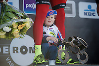 Go dad!<br /> Alexander Kristoff's (NOR/Katusha) son hides between his dads legs on the podium<br /> <br /> 99th Ronde van Vlaanderen 2015