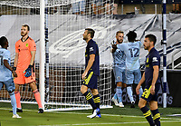 KANSAS CITY, KS - OCTOBER 11: #7 Johnny Russell and #12 Gerso Fernandes of Sporting Kansas City celebrate Gerso's goal during a game between Nashville SC and Sporting Kansas City at Children's Mercy Park on October 11, 2020 in Kansas City, Kansas.
