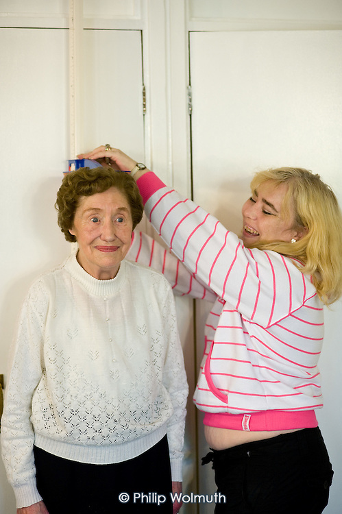 Social afternoon, with health information, massage and flower arranging, at Juniper House, sheltered accommodation for the elderly, Avenue Gardens Estate, Queen's Park.