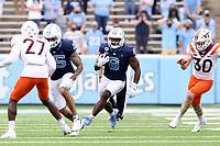 CHAPEL HILL, NC - OCTOBER 10: Michael Carter #8 of North Carolina rushes 62 yards for a touchdown during a game between Virginia Tech and North Carolina at Kenan Memorial Stadium on October 10, 2020 in Chapel Hill, North Carolina.