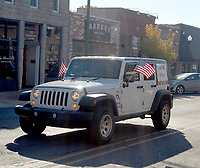 Marc Hayot/Herald Leader A vehicle drives by with a sign thanking veterans on the rear side window during the 2019 Veterans Day Parade.
