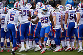 Buffalo Bills quarterback Tyrod Taylor (5) shakes hands with Robert Blanton (29) during introductions before an NFL Wild-Card football game against the Jacksonville Jaguars, Sunday, January 7, 2018, in Jacksonville, Fla.  (Mike Janes Photography)