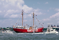 The Nantucket, a red, two masted boat at the historical Tall Ships exhibit. Sailing. Rhode Island.