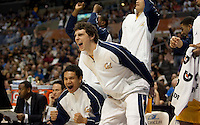 Brandon Smith and Nikola Knezevic celebrate from the bench. The California Golden Bears defeated the UCLA Bruins 85-72 during the semifinals of the Pacific Life Pac-10 Conference Tournament at Staples Center in Los Angeles, California on March 12th, 2010.