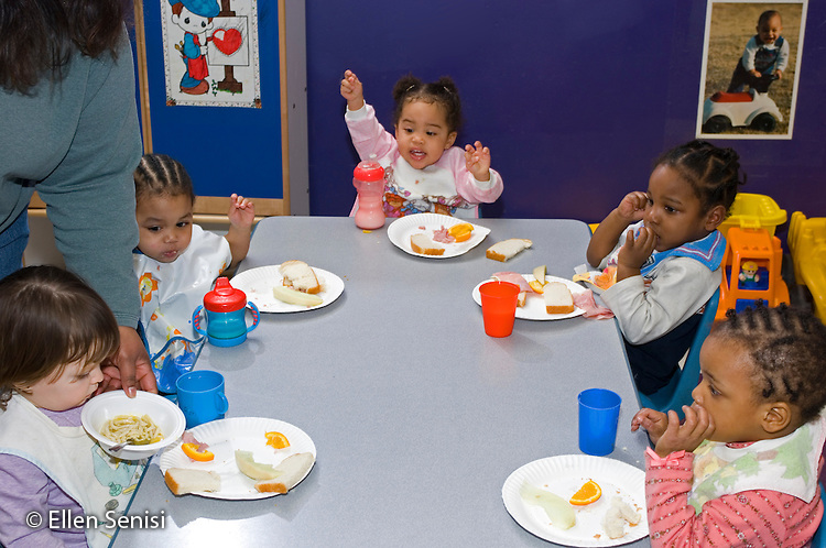 MR / Schenectady, NY.Schenectady Day Nursery / private non-profit daycare center / Toddler class.Toddlers sit around table eating lunch..MR: AG-SDNT.© Ellen B. Senisi