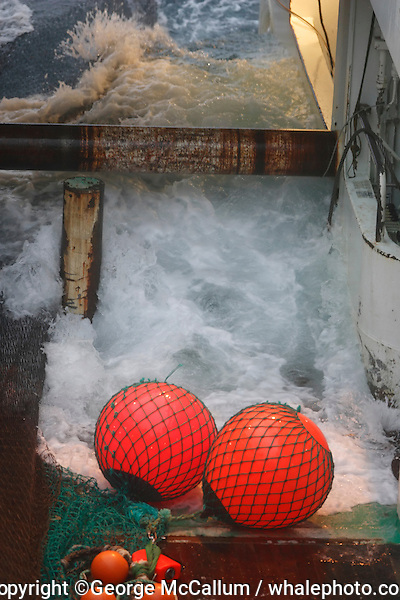 Wave inundating trawl deck on fishing trawler during storm Barents sea arctic Norway
