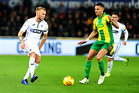Mike van der Hoorn of Swansea City vies for possession with Kieran Gibbs of West Bromwich Albion during the Sky Bet Championship match between Swansea City and West Bromwich Albion at the Liberty Stadium in Swansea, Wales, UK. Wednesday 28 November 2018
