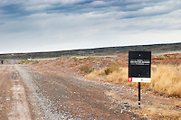 Very end of the world long straight dirt road across the Patagonian desert with a sign to the bodega del fin del Mundo Bodega Del Fin Del Mundo - The End of the World - Neuquen, Patagonia, Argentina, South America