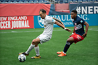 FOXBOROUGH, MA - APRIL 17: Hernan Gonzalez #19 of Richmond Kickers controls the ball under pressure from Francois Dulysse #60 of New England Revolution II during a game between Richmond Kickers and Revolution II at Gillette Stadium on April 17, 2021 in Foxborough, Massachusetts.