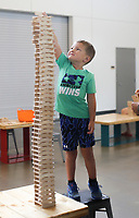 Sawyer Deathe, 5, of Lawrence, Kans. uses Keva planks to build a tower, Friday, July 16, 2021 at the Amazeum in Bentonville. The Amazeum's latest exhibit Creativity Cubed: Think Outside the Blocks, created by the Amazeum team, invites guests to explore their own creativity through a timeless medium - the block. Blocks are infinitely adaptable to the imagination of the user. Check out nwaonline.com/210717Daily/ for today's photo gallery. <br /> (NWA Democrat-Gazette/Charlie Kaijo)