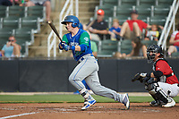 Nick Hutchins (30) of the Lexington Legends follows through on his swing against the Kannapolis Intimidators at Kannapolis Intimidators Stadium on August 4, 2019 in Kannapolis, North Carolina. The Legends defeated the Intimidators 5-1. (Brian Westerholt/Four Seam Images)