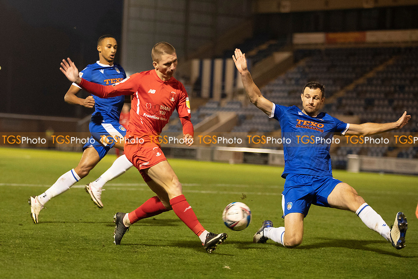 Sam Ling, Leyton Orient cross is blocked by Tommy Smith, Colchester United during Colchester United vs Leyton Orient, Sky Bet EFL League 2 Football at the JobServe Community Stadium on 14th November 2020