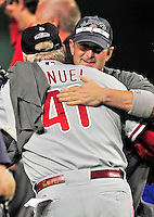 27 September 2010: Philadelphia Phillies' catcher  Brian Schneider hugs Manager Charlie Manuel after a division-clinching shutout against the Washington Nationals at Nationals Park in Washington, DC. With the 8-0 win, the Philles become the National League Eastern Division Champions. Mandatory Credit: Ed Wolfstein Photo