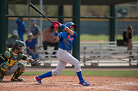 Chicago Cubs shortstop Aramis Ademan (11) follows through on his swing during a Minor League Spring Training game against the Oakland Athletics at Sloan Park on March 13, 2018 in Mesa, Arizona. (Zachary Lucy/Four Seam Images)