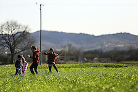 Pictured: Refugee children play in the fields by the camp Thursday 25 February 2016<br /> Re: Refugees have been left stranded in temporary camps after Greek FYRO Macedonian borders were closed in Idomeni, northern Greece.