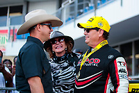 Oct 20, 2019; Ennis, TX, USA; NHRA top fuel driver Billy Torrence (right) celebrates with son Steve Torrence (left) and wife Kay Torrence after winning the Fall Nationals at the Texas Motorplex. Mandatory Credit: Mark J. Rebilas-USA TODAY Sports