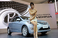A model poses beside a Hyundai Verna at its world premiere at the Beijng Auto Show. The car show has attracted all the world's major auto markers. China's vehicle sales have breached the 10-million barrier for the first time ever, with 10.9 million automobiles sold last year. .24 Apr 2010