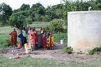 Tanzania.  Serengeti.  Maasai Villagers of Ololosokwan at Water Storage Facility.