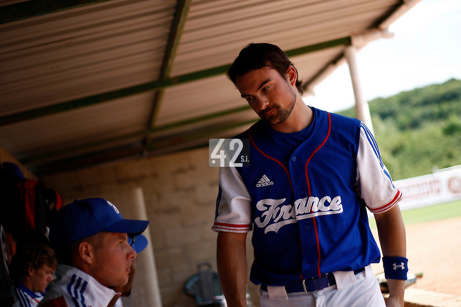 25 June 2011: Florian Peyrichou of Team France. Illustration of a photographic essay called Life in the dugout, during Czech Republic 11-1 win over France, at the 2011 Prague Baseball Week, in Prague, Czech Republic.