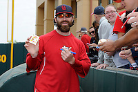 St. Louis Cardinals pitcher Jason Motte #30 signs autographs before a Spring Training game against the Houston Astros at Osceola County Stadium on March 1, 2013 in Kissimmee, Florida.  The game ended in a tie at 8-8.  (Mike Janes/Four Seam Images)