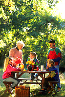 Family spending quality time together while having a picnic outdoors