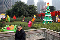 CHINA. Sichuan Province. Chongqing. A man in a park surrounded by christmas decorations. Chongqing is a city of over 3,000,000 people, famed for being the capital of China between 1938 and 1946 during World War II. It is situated on the banks of the Yangtze river, China's longest river and the third longest in the world. Originating in Tibet, the river flows for 3,964 miles (6,380km) through central China into the East China Sea at Shanghai.  2008