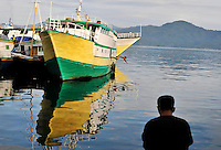 A deckhand dives from his boat in the main port at Ambon City. The 1999-2002 religious war between Maluku's Christian and Muslim populations, mainly centred on Ambon Island, led to over 5000 deaths and to around 500,000 people become displaced. Destroyed homes and offices, churches and mosques are slowly being either torn-down or renovated.  Urban centres, such as Ambon City, continue to be split along largely sectarian lines, and tensions are never far below the surface. Riots between Christian and Muslim youths erupted in September 2011 and, most recently, June 2012, though luckily simmered down just as quickly, partly due to community leaders learning how to defuse tensions from the earlier, more devastating, conflagration. /Felix Features