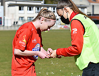 Magali Dinon (6) of Woluwe pictured receiving aid from Lies Tambeur (15) of Woluwe during a female soccer game between FC Femina White Star Woluwe and KRC Genk on the 17 th matchday of the 2020 - 2021 season of Belgian Scooore Womens Super League , Saturday 20 th of March 2021  in Woluwe , Belgium . PHOTO SPORTPIX.BE | SPP | JILL DELSAUX