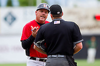 Hickory Crawdads manager Bill Richardson #24 has a discussion with home plate umpire Ben Leake during the game against the Greensboro Grasshoppers at L.P. Frans Stadium on May 18, 2011 in Hickory, North Carolina.   Photo by Brian Westerholt / Four Seam Images