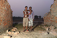 Two child workers stand in a brick factory, in the Malancha district of eastern Kolkata. India. November, 2013