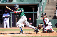 Great Lakes Loons outfielder Andy Pages (44) follows through on his swing on May 30, 2021 against the Lansing Lugnuts at Jackson Field in Lansing, Michigan. (Andrew Woolley/Four Seam Images)