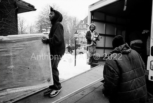Cleveland, Ohio<br /> March 25, 2008 <br /> <br /> Delivering warning and final eviction notices Detective Robert Kole of the Cuyahoga County Sheriff's Department enters every situation with caution. When the residents are at the home he must assure that all is final and that the home is clear of weapons and that the residents are indeed moving out. <br /> <br /> If no one is there, then he must authorize that the door be forcibly open. He then enters and clears the house at gunpoint in hopes that there are no squatters or inhabitants threaten himself or the movers. He also clears the house for weapons.<br /> <br /> All emotions and fears are on the surface as some residents greet him by crying on his shoulder while others can threaten him with a weapon.<br /> <br /> In this intercity Cleveland home the family and friends of Marian Taylor help her move her goods from the home after foreclosing on the loan.