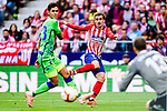 Antoine Griezmann of Atletico de Madrid (R) in action against Aissa Mandi of Real Betis (L) during the La Liga 2018-19 match between Atletico de Madrid and Real Betis at Wanda Metropolitano Stadium on October 07 2018 in Madrid, Spain. Photo by Diego Souto / Power Sport Images