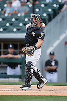 Charlotte Knights catcher George Kottaras (20) makes a throw to third base against the Louisville Bats at BB&T BallPark on May 12, 2015 in Charlotte, North Carolina.  The Knights defeated the Bats 4-0.  (Brian Westerholt/Four Seam Images)