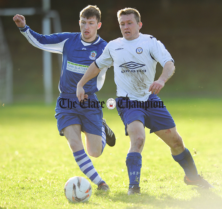 Tommy Mc Keown of Tulla United in action against Adrian Walsh of Ennis town during their Premier League game at Lees Road. Photograph by John Kelly.
