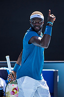 10th February 2021, Melbourne, Victoria, Australia; Frances Tiafoe of the United States of America celebrates after winning a game during round 2 of the 2021 Australian Open on February 10 2020, at Melbourne Park in Melbourne, Australia.